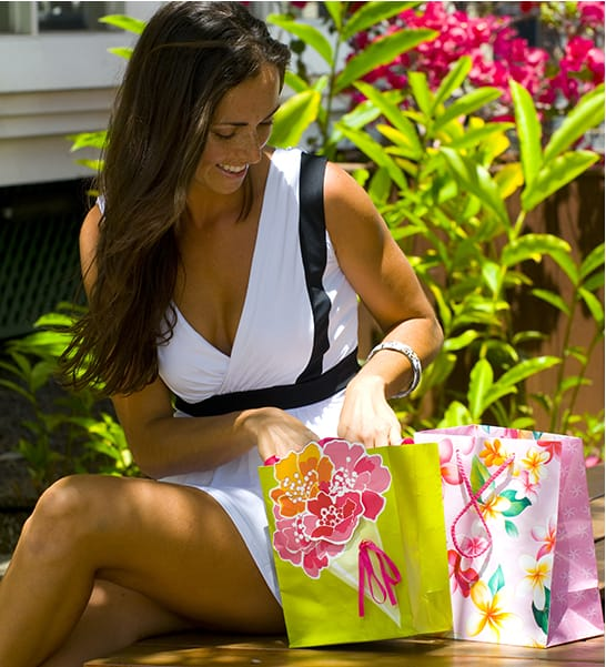 A woman looks into gift bags with new purchases