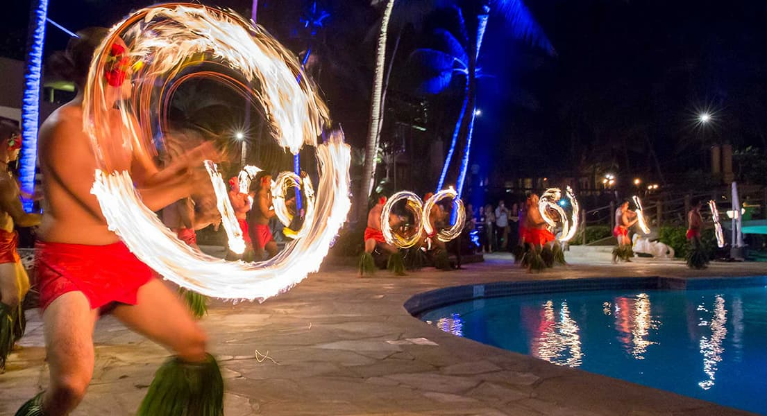 A fire dancer twirls a flaming stick