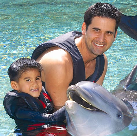 Family visiting Dolphin Quest