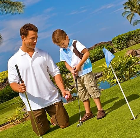 Father and son playing on the resort putting course
