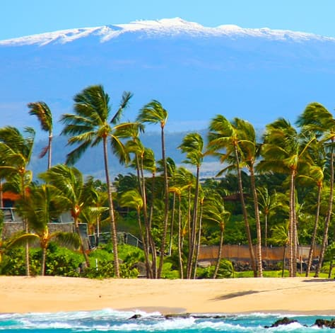 View from Mauna Kea with snow from  a warm, sunny beach